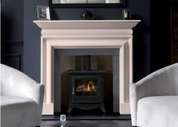 Chesneys' Clanden fireplace in Portuguese limestone shown with Chesneys' Beaumont gas stove