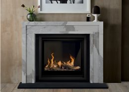 Chesneys' Manhattan fireplace in veined statuary marbleshown with the Bellfires Unica-2 inset gas fire