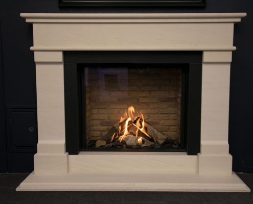 Natura Fireplaces Grace in in Semi-Rijo with honed black granite slips