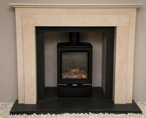 Natura Fireplaces Wentworth in Marsden Beige Limestone with matching chamber and Antique Nero Granite slips, hearth and back hearth