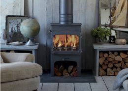 Wildwood 5kW woodburning stove with integral log store style base