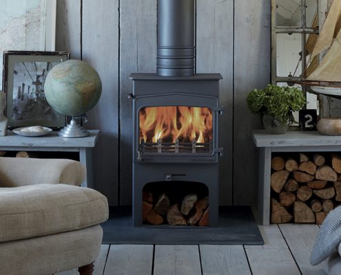 Wildwood 5kW woodburning stove with integral log store style base